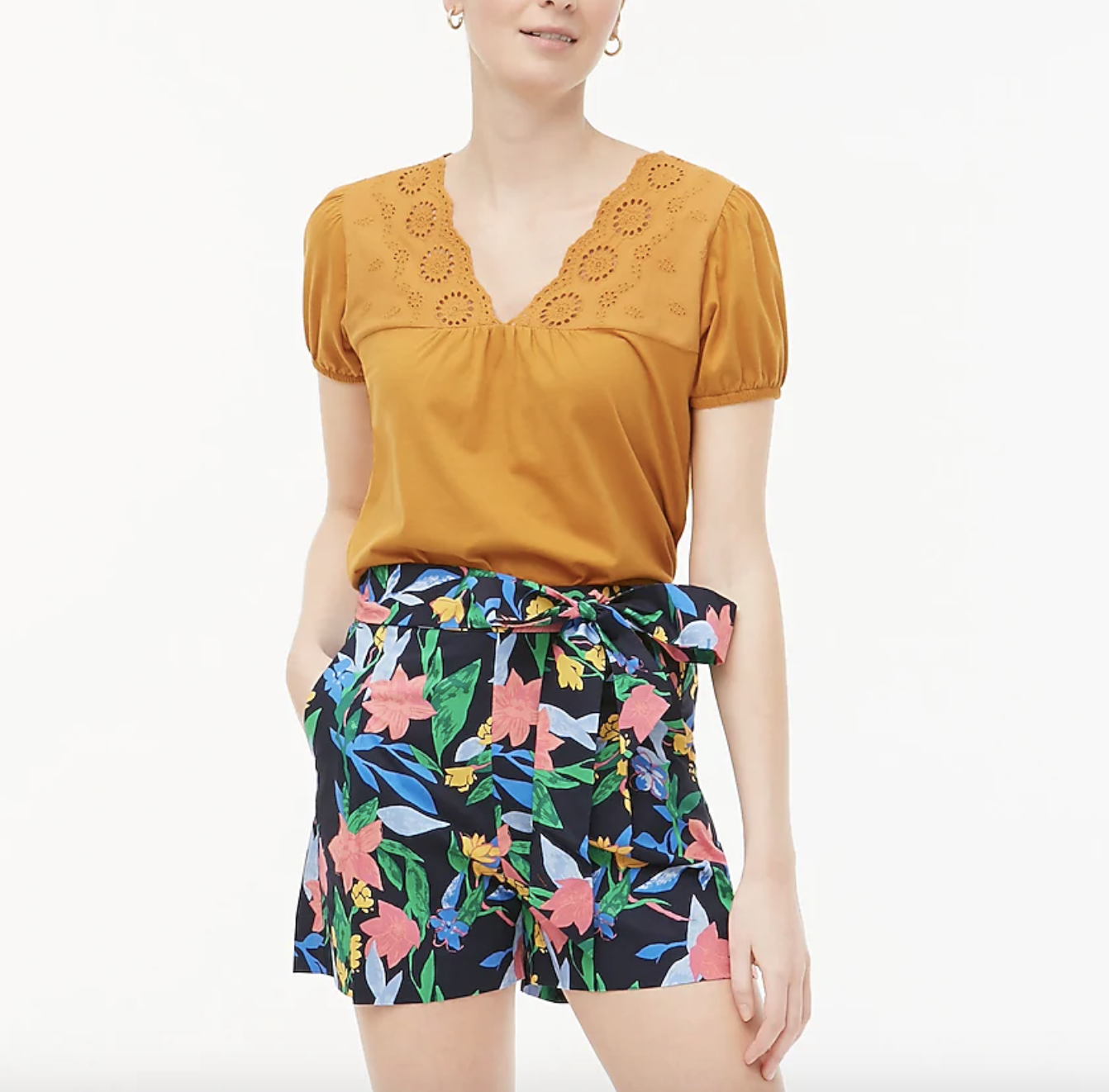 the shorts, which are black with a floral pattern