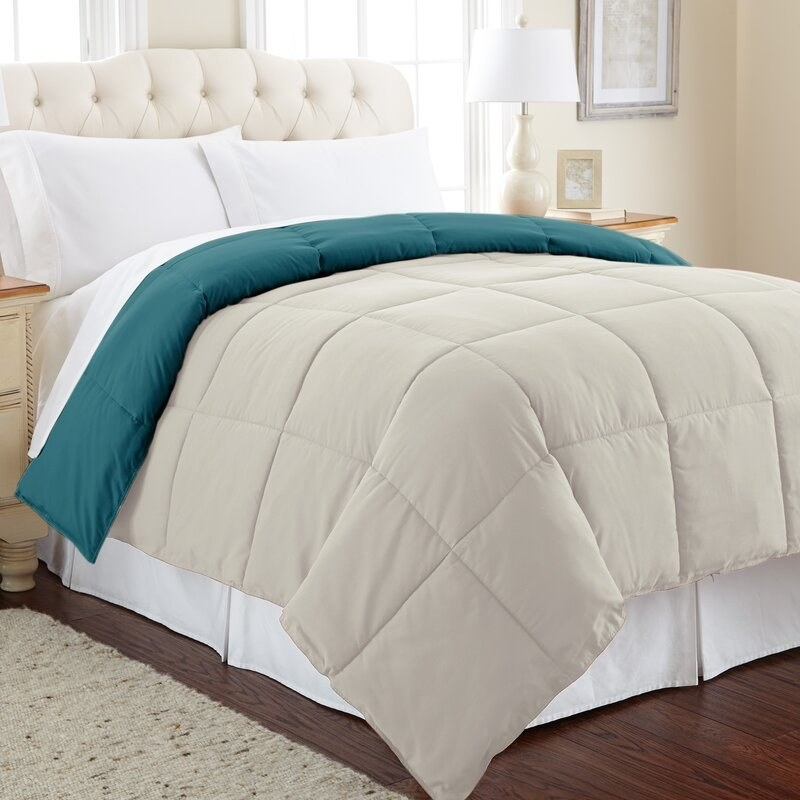 The quilted comforter in blue and oatmeal