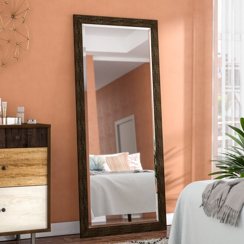 The mirror with a dark brown frame