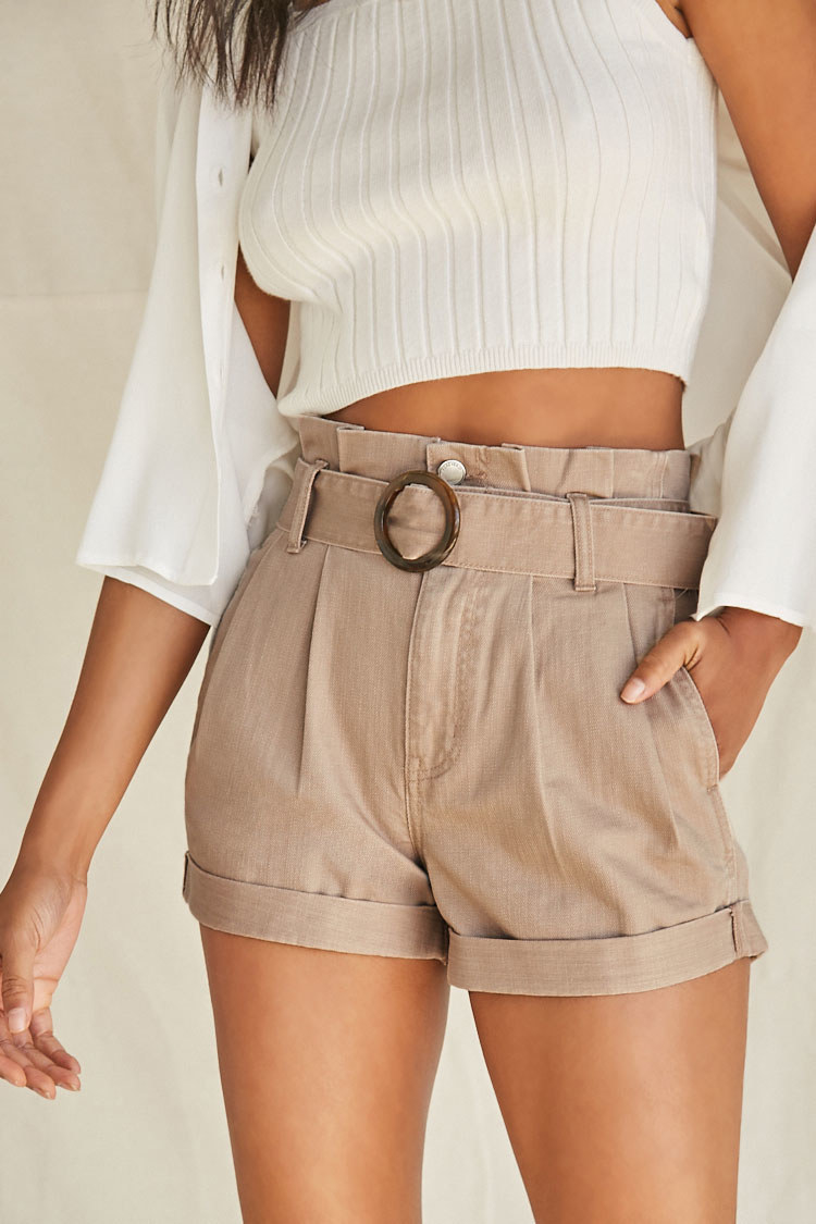 Model wearing the shorts in khaki