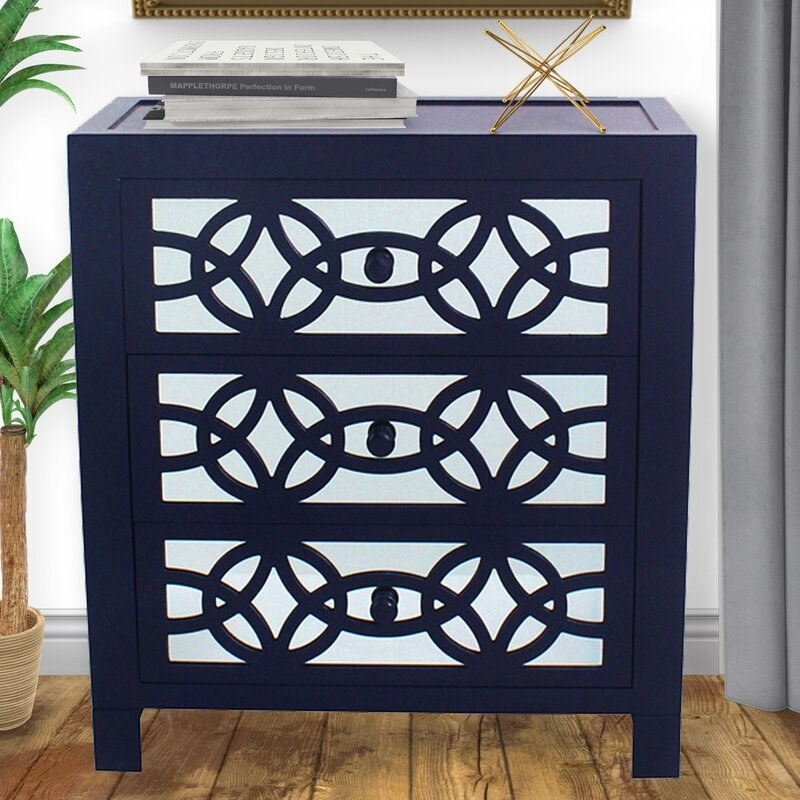 The chest in navy, featuring a mirrored finish