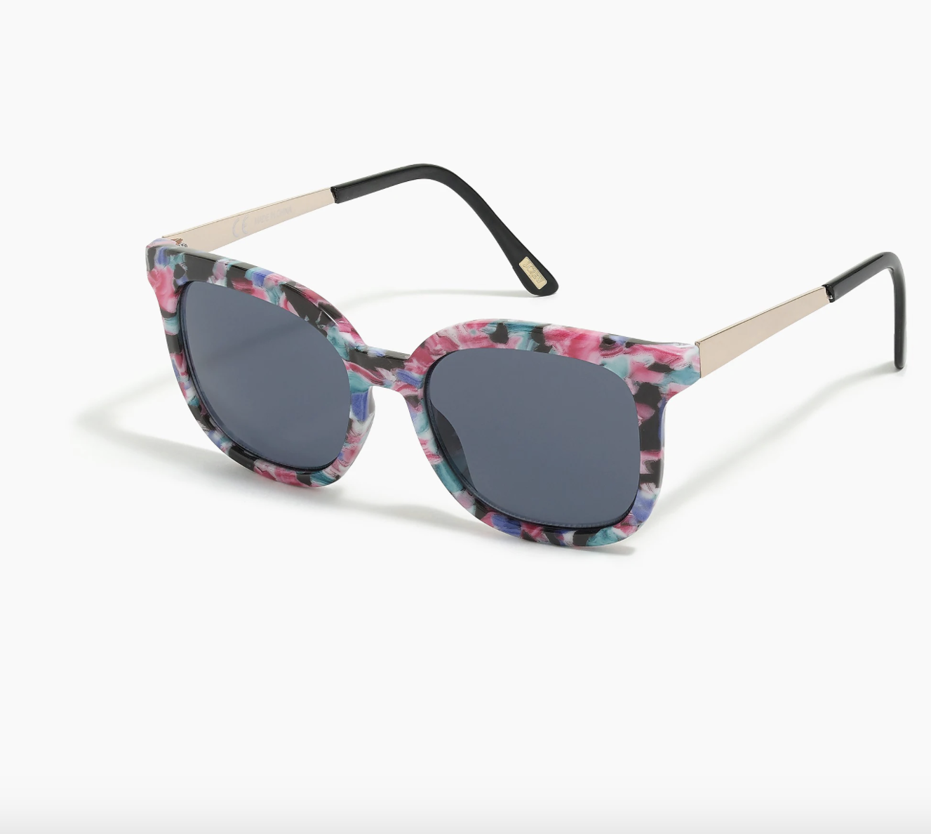 the sunglasses, which are black with a floral pattern around the border