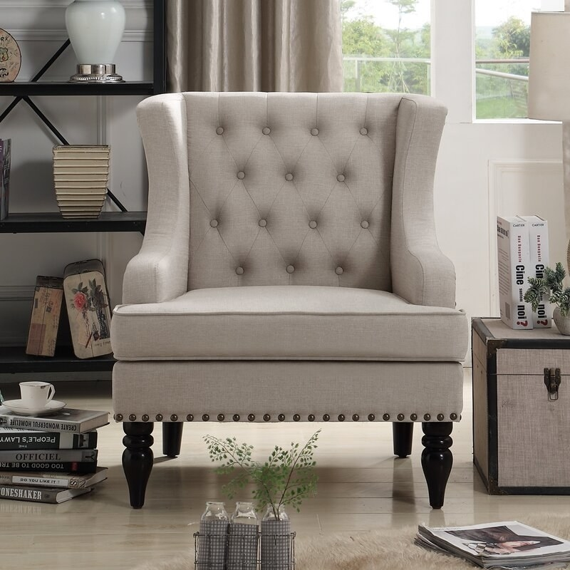 The tufted chair in beige