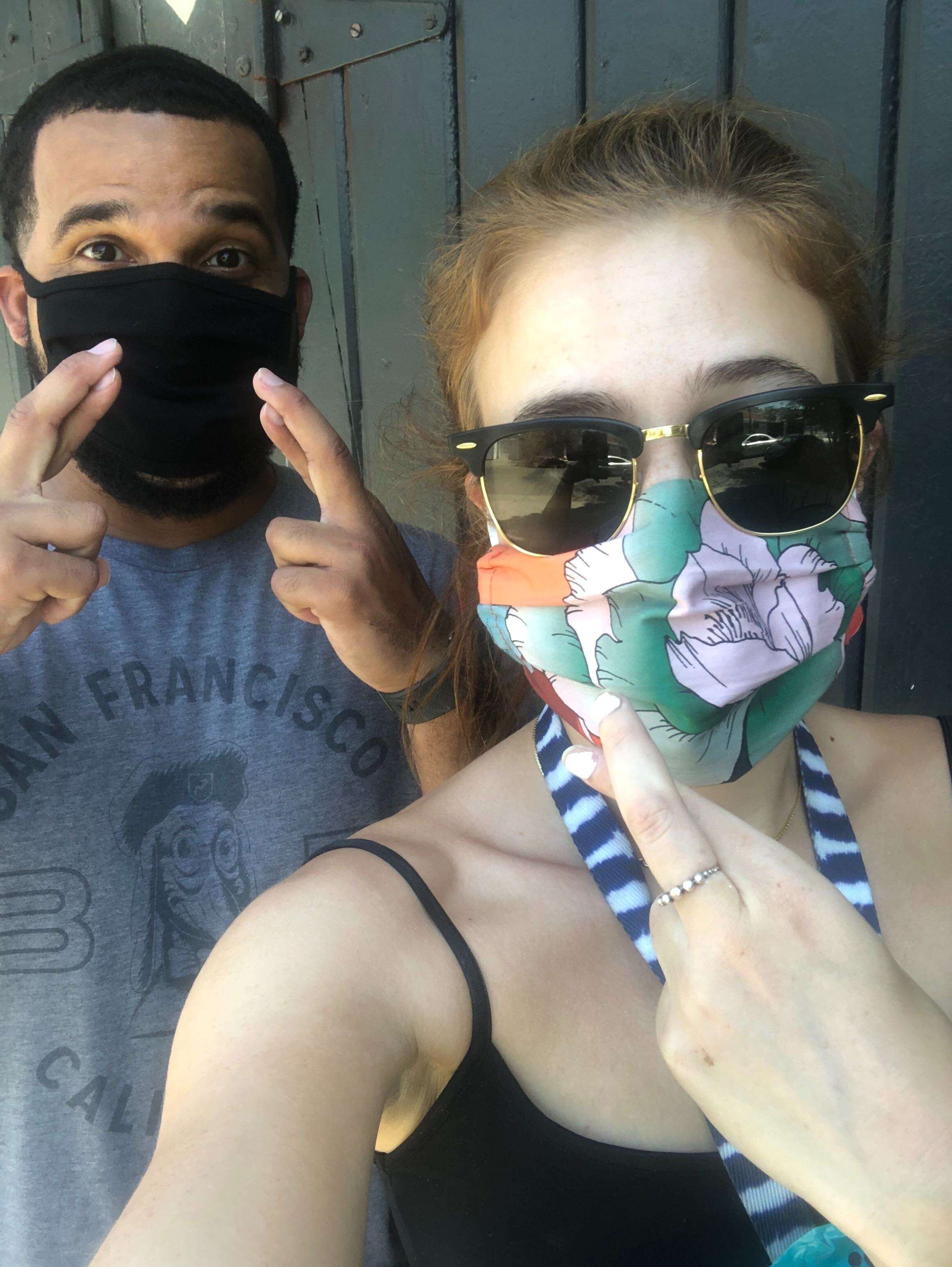 Selfie of Daniella and Troy with masks on, crossing our fingers.