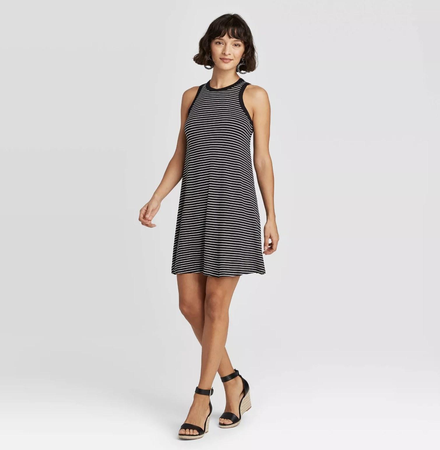 Model wearing the striped tank dress