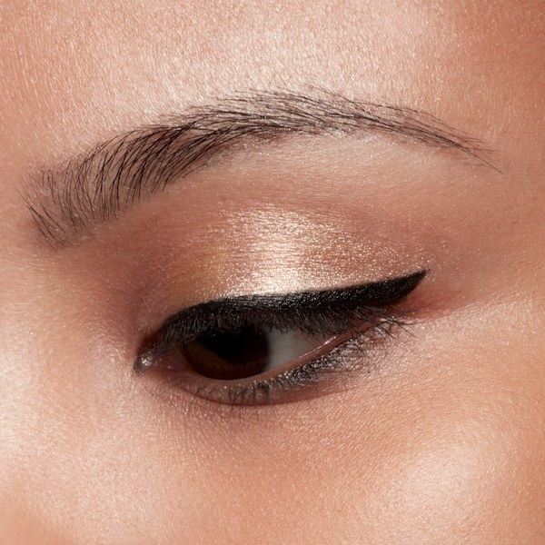 Model wearing a shimmery pink-gold shade