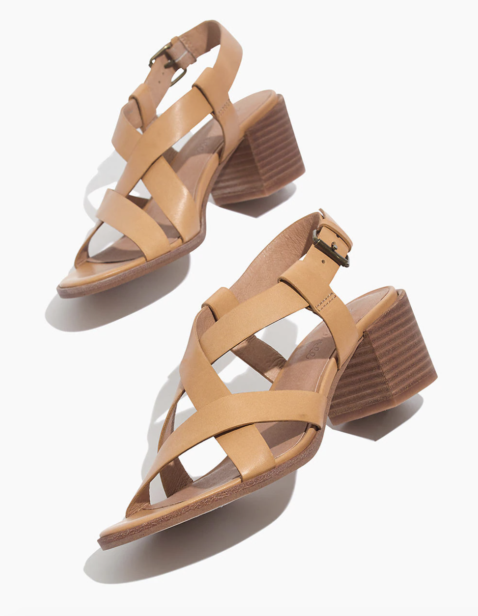 tan heels with criss-crossed straps and a chunky wooden block heel