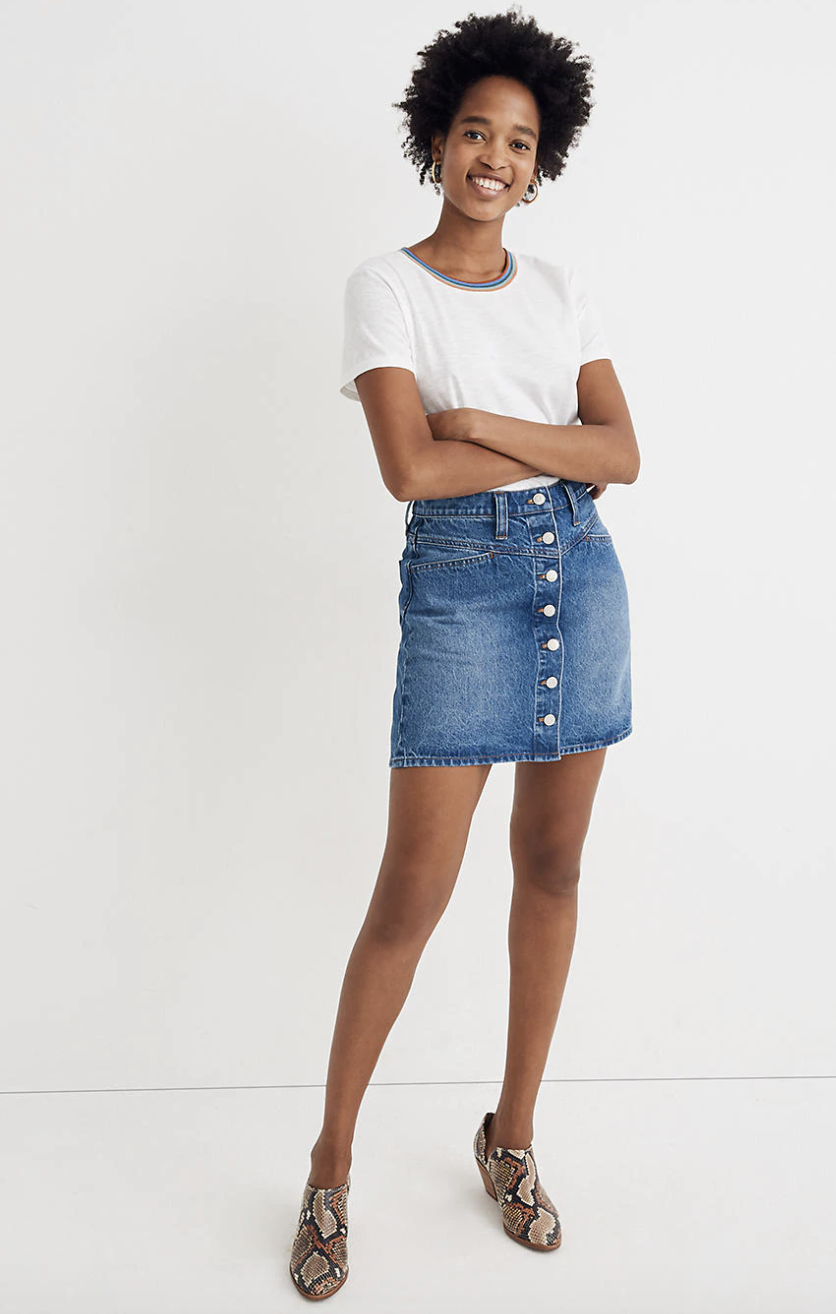 a model wearing the medium wash denim skirt