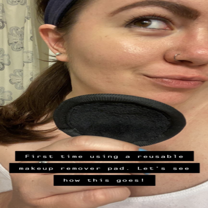 Reviewer pic with a full face of makeup holding the resuable pad