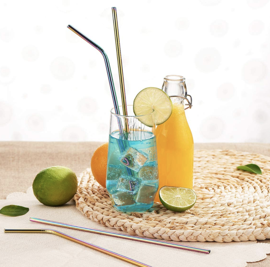 Iridescent reusable straws in a glass with a blue carbonated beverage
