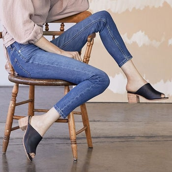 model wearing the shoes with jeans and pink top
