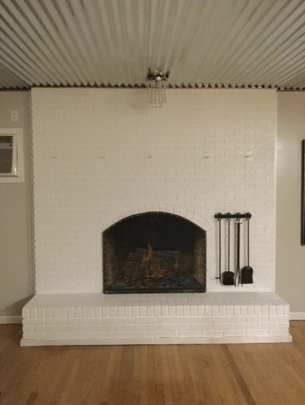 A reviewer's fireplace painted white with the additive