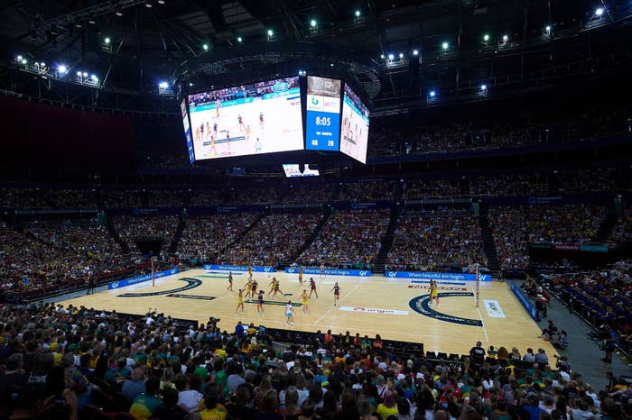 Full stadium of spectators watching netball game