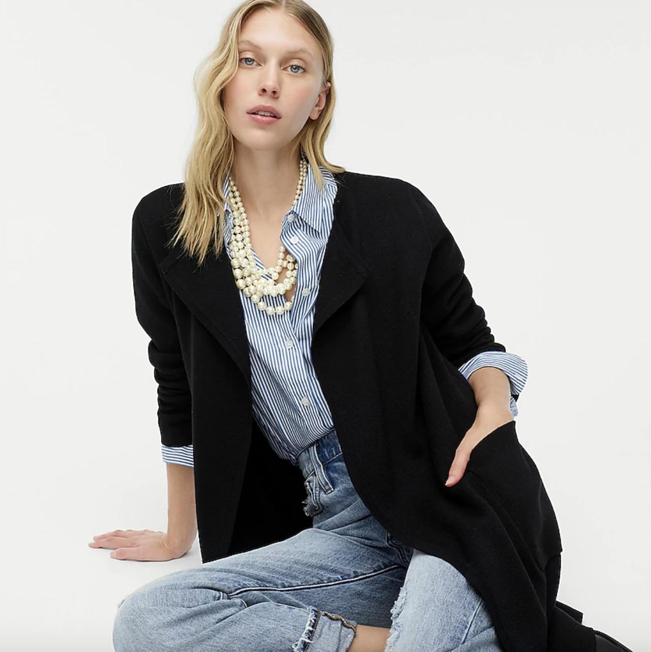 model wearing black collarless sweater-blazer
