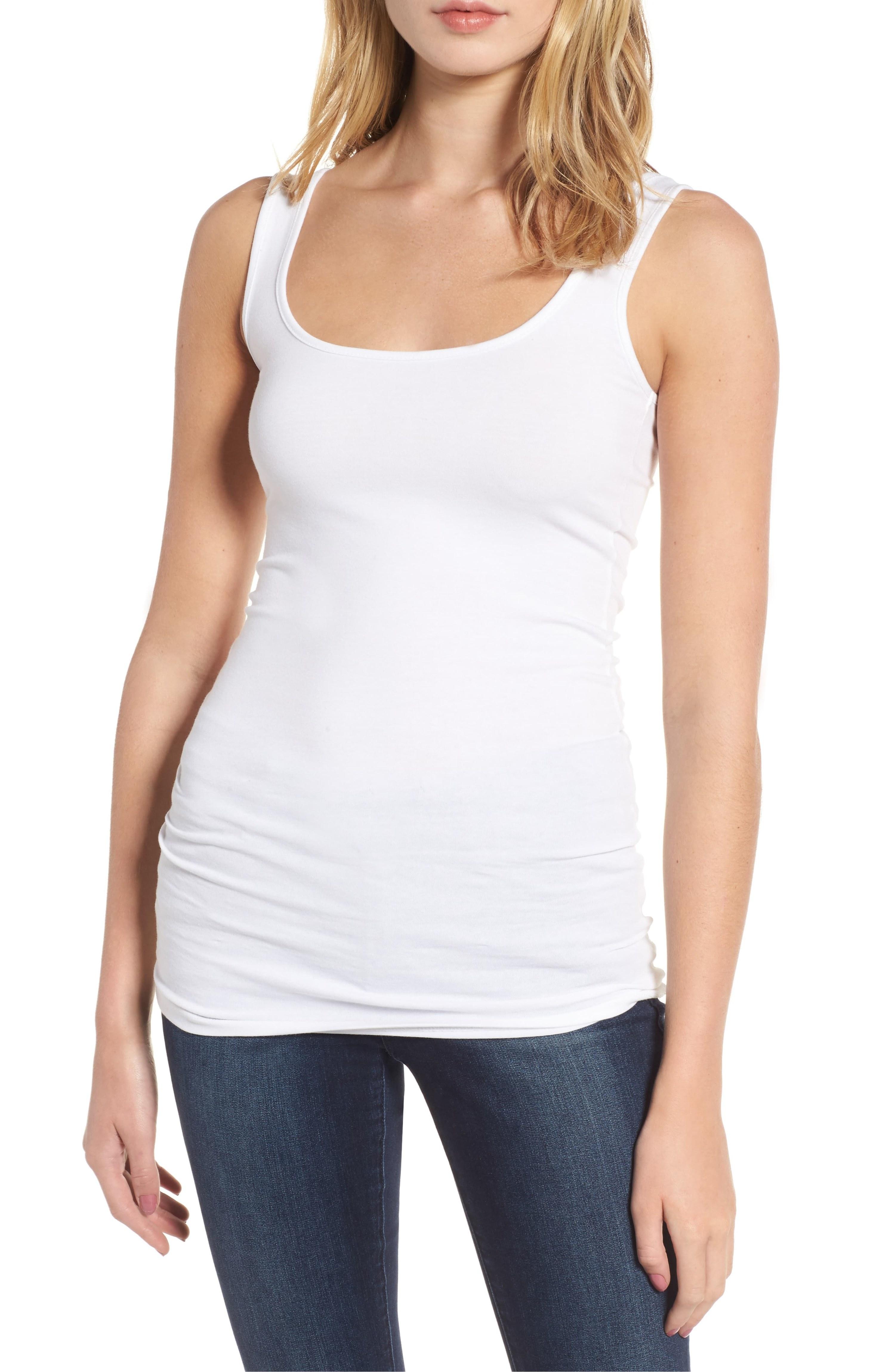 model wearing white tank