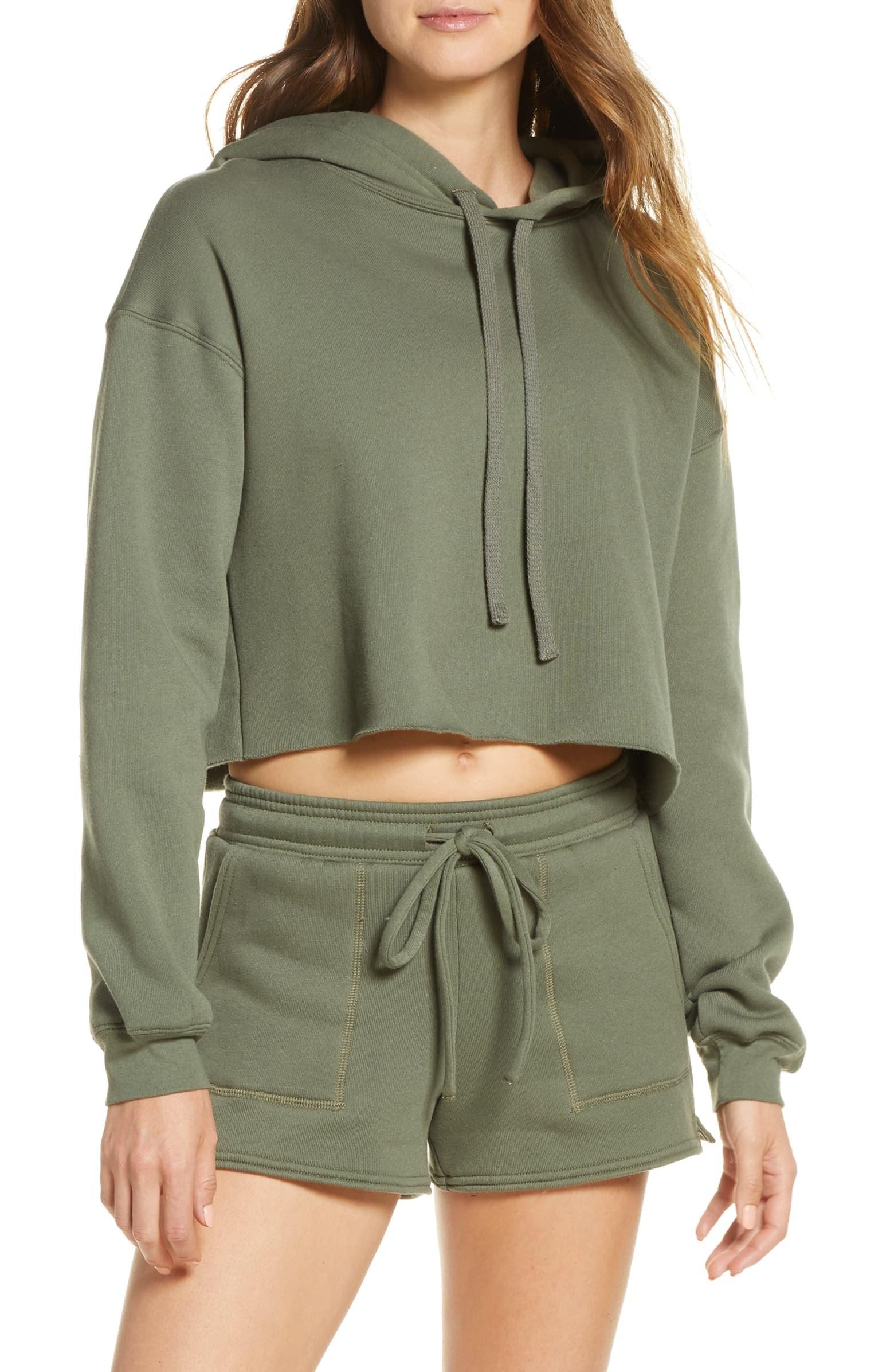 model wearing olive green hoodie
