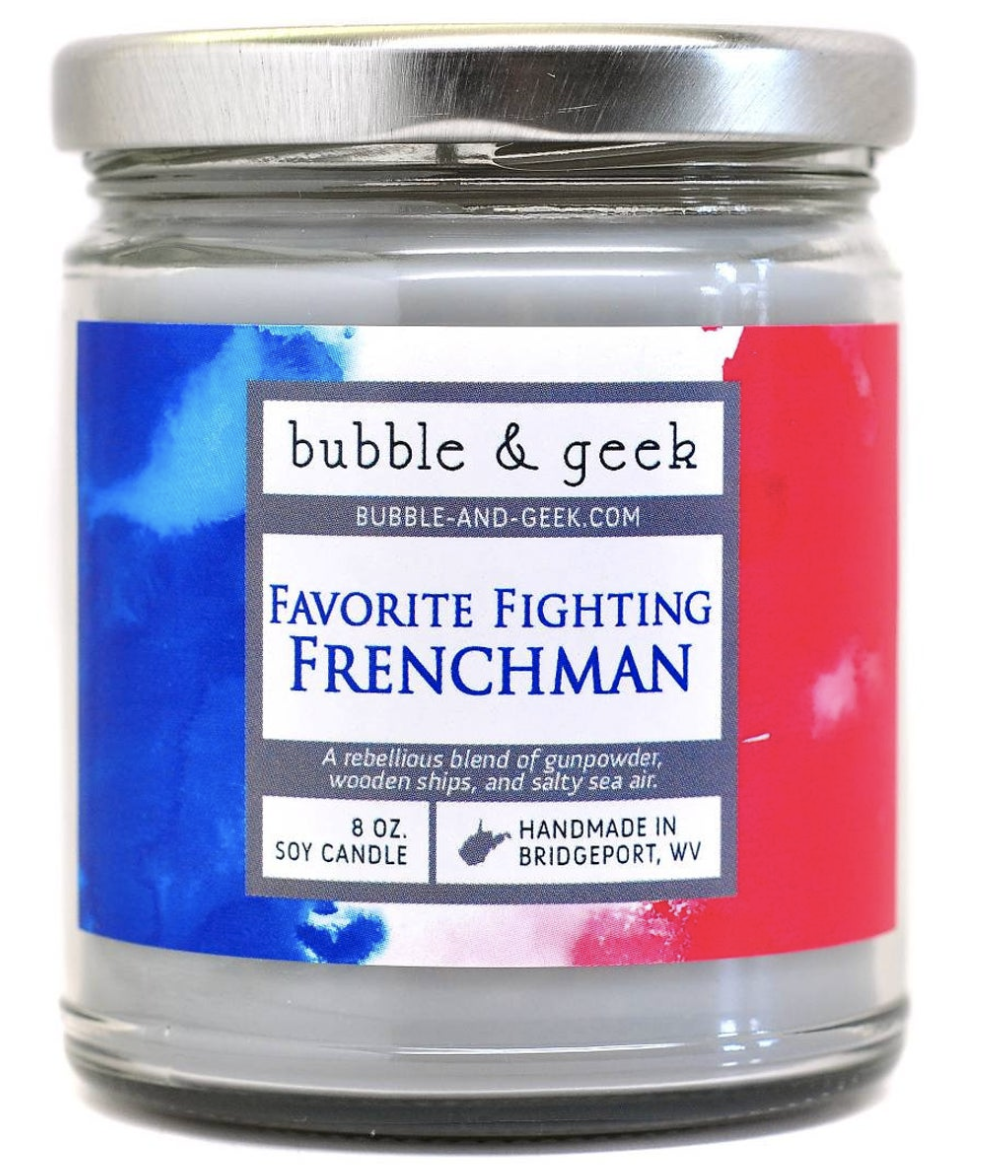 The candle, which has a French flag pattern on it