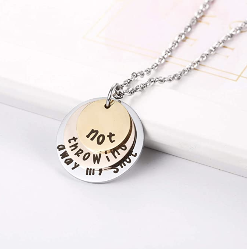 """A layered necklace that says """"not"""" on the first layer, """"throwing"""" on the second, and """"away my shot"""" on the third"""