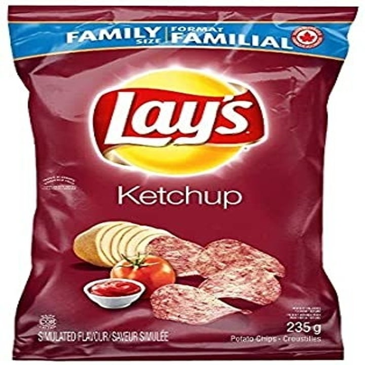 A red bag of Lay's ketchup chips in front of a white background.