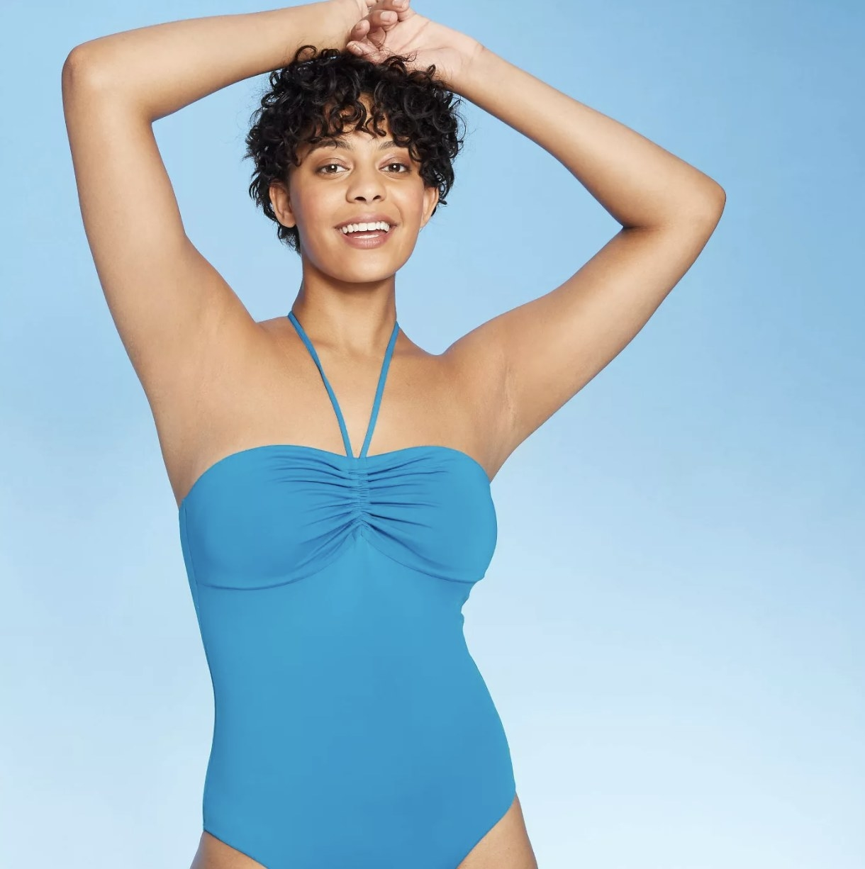 A model in the blue one piece