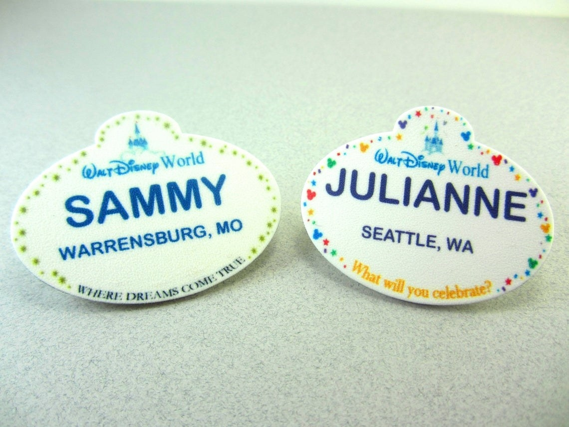 Two customized Disney World name tags with the names Sammy and Julianne and their locations.
