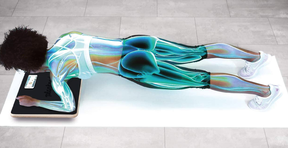Model uses interactive Plankboard to strengthen their arms, legs, and back