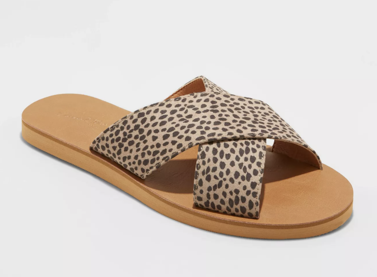 flat slides with criss crossing straps in an understated leopard print