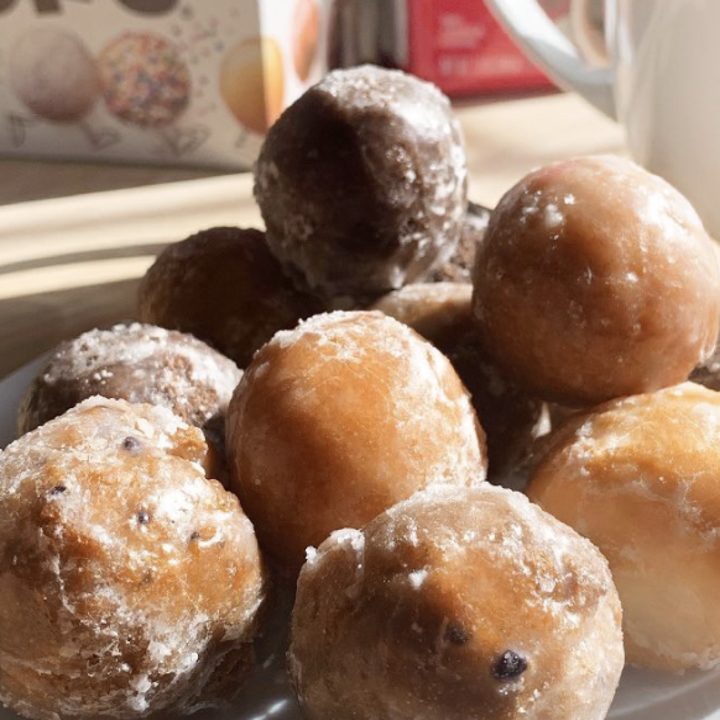 A pile of chocolate and vanilla-glazed donut holes, called Timbits when they're from Tim Hortons in Canada.