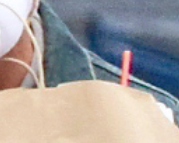 a closeup of a straw sticking out behind the bag