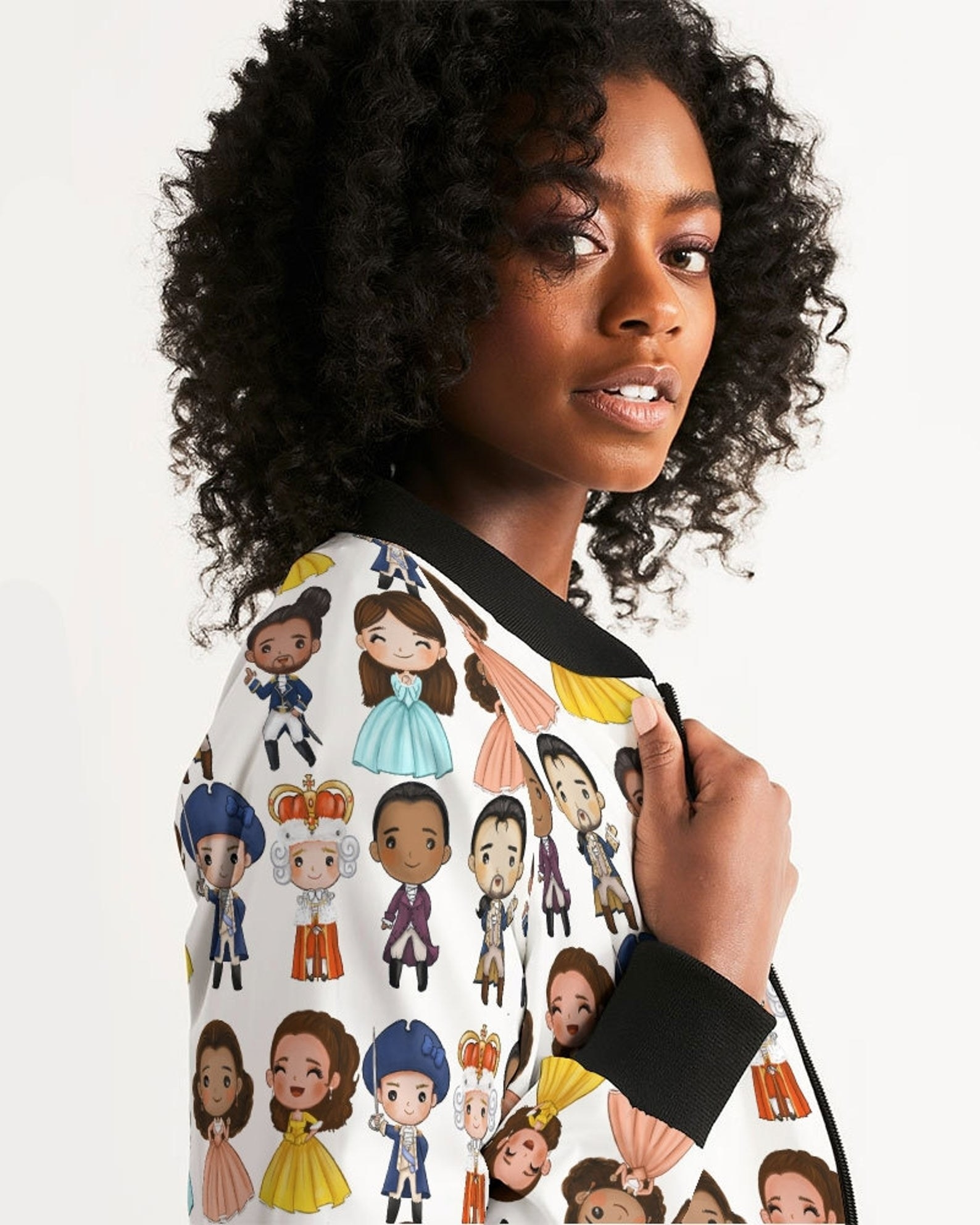 A model in a bomber jacket with cartoon Hamilton characters on it