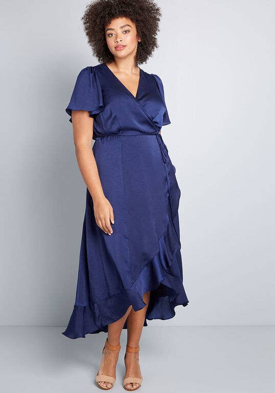Model wearing the dress in dark blue