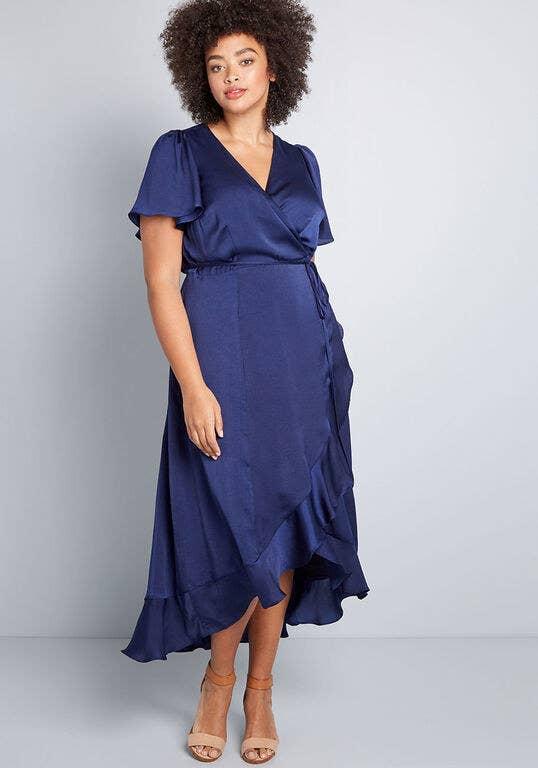 Model wearing the dress in dark blue