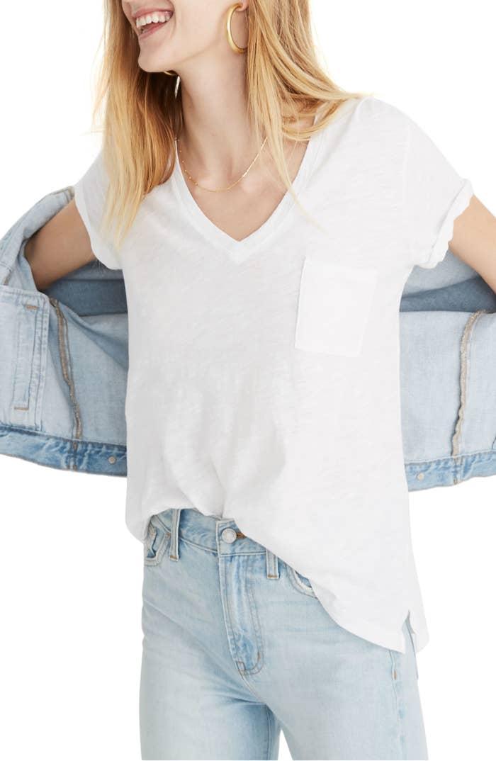 model wearing white pocket V-neck tee