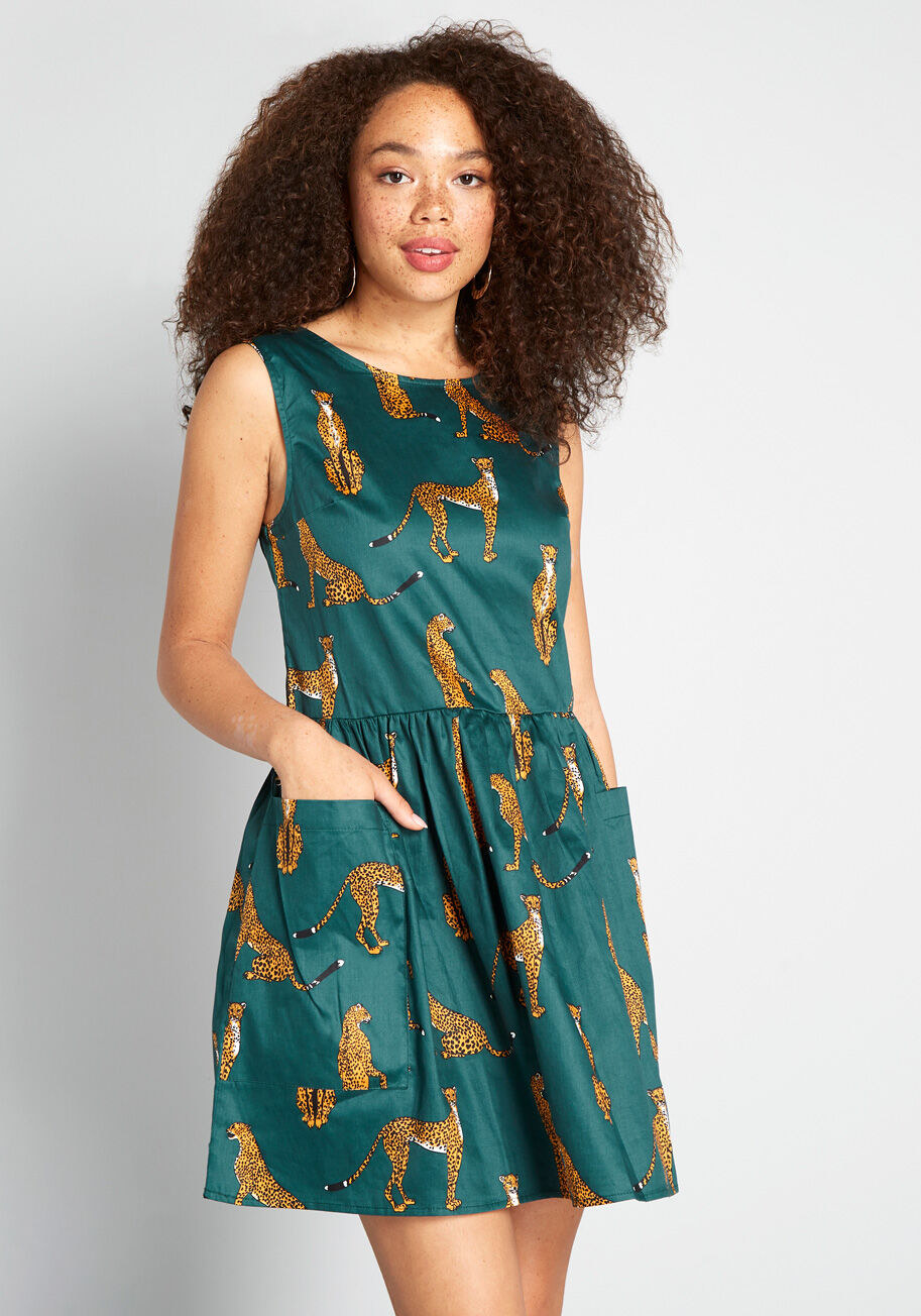 Model wearing the green cheetah printed dress