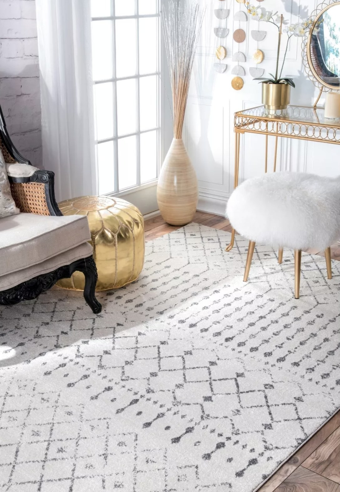 A white area rug with faded black details