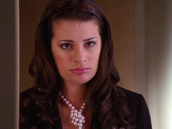 Rachel angrily looks into a classroom.