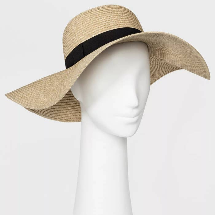 A floppy straw hat with a black ribbon at the brim