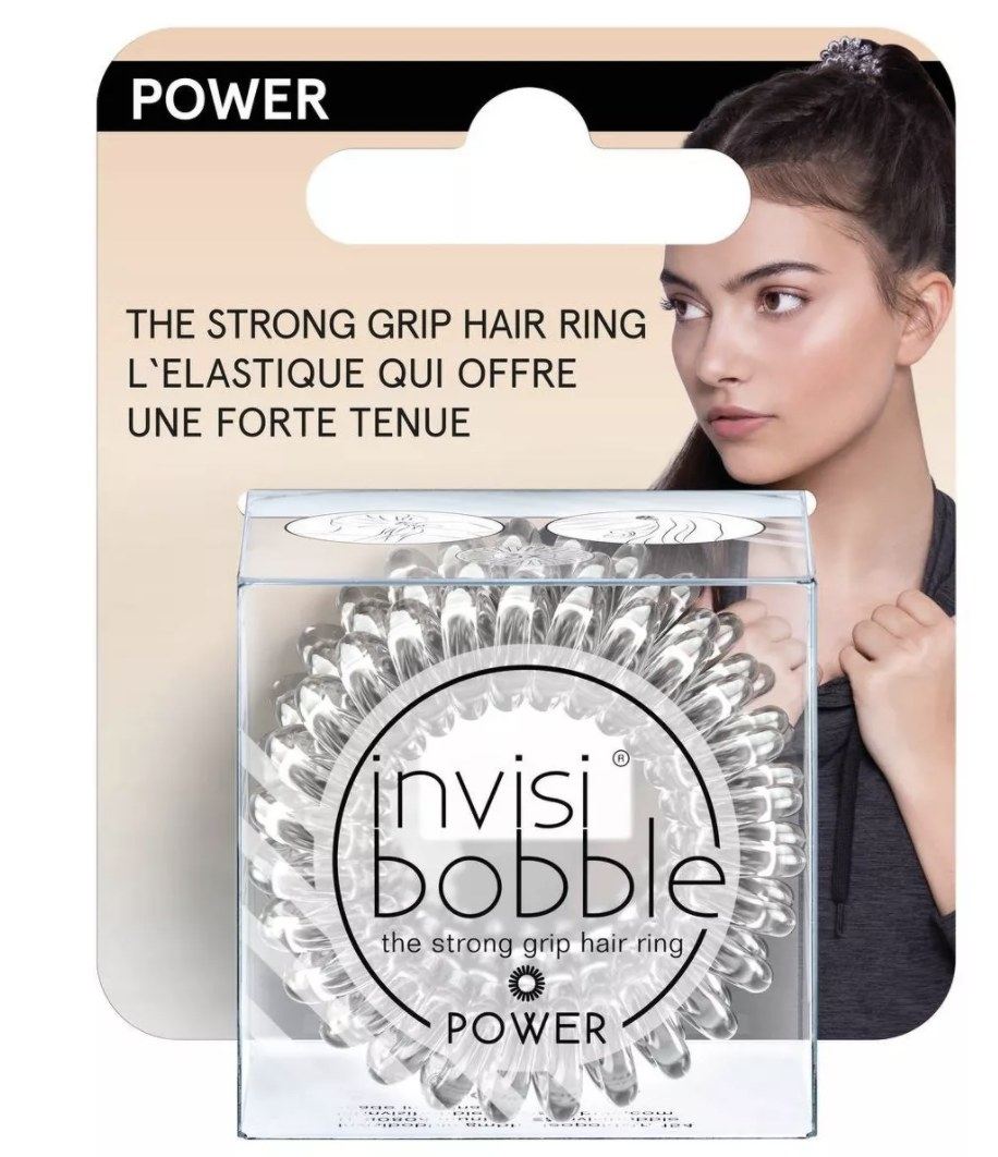 A coiled, transparent hair ring