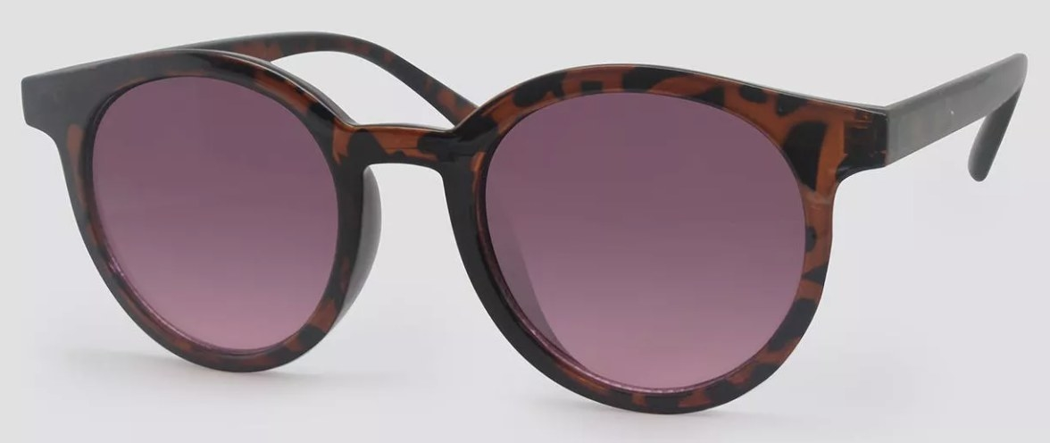 A pair of  animal print round sunglasses with tinted frames