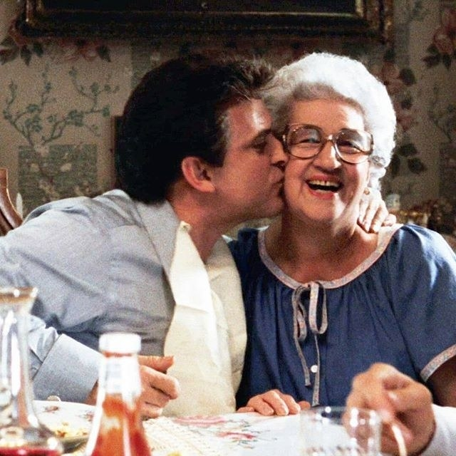 Joe Pesci kissing Catherine Scorsese in a scene from Goodfellas