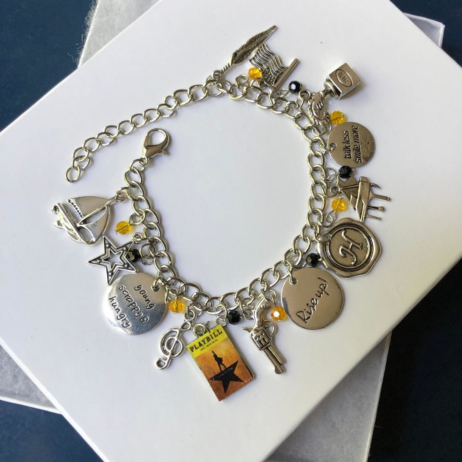 A bracelet with Hamilton-related charms and quotes on it