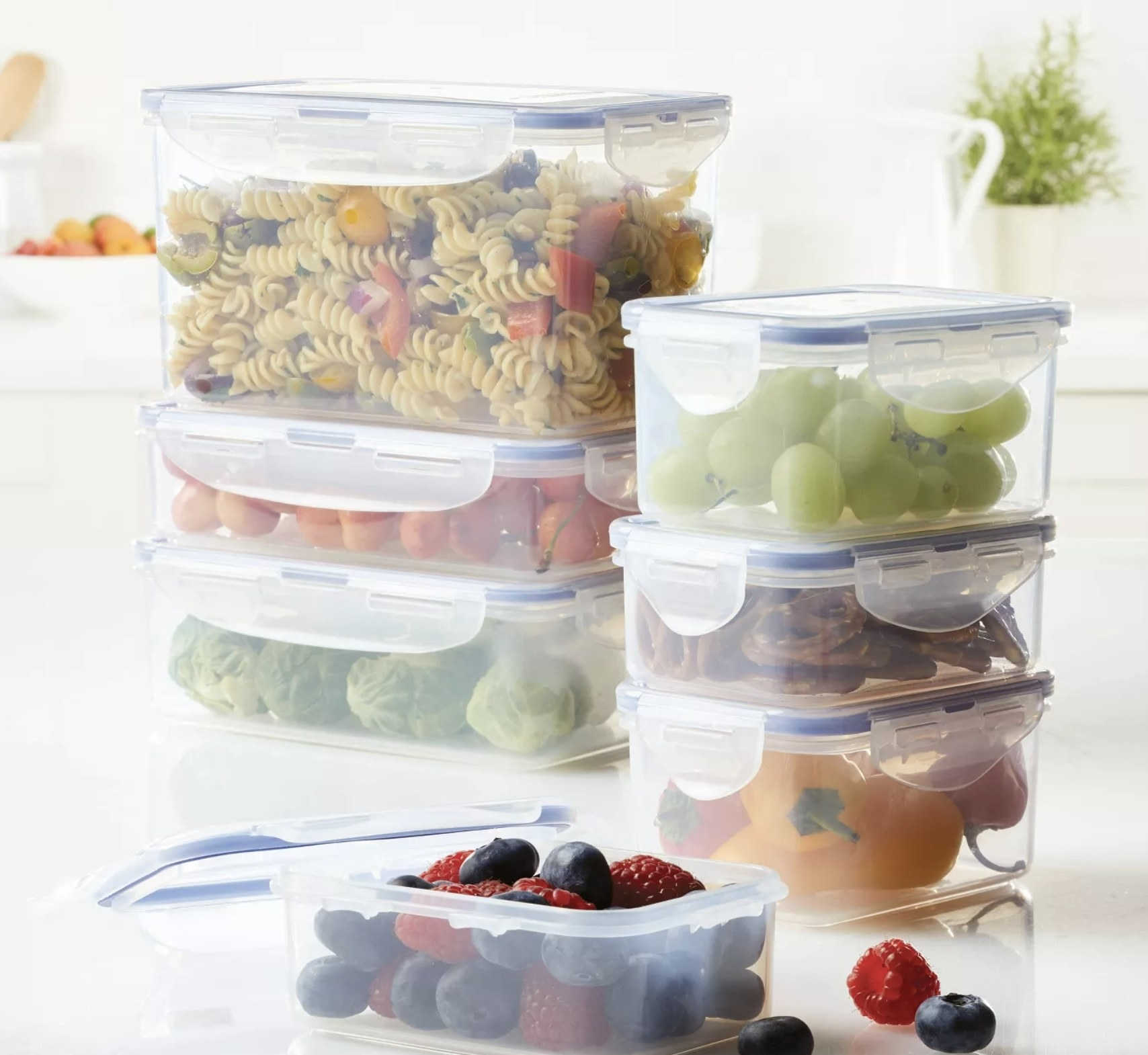 Food packed into seven clear containers with snap lids