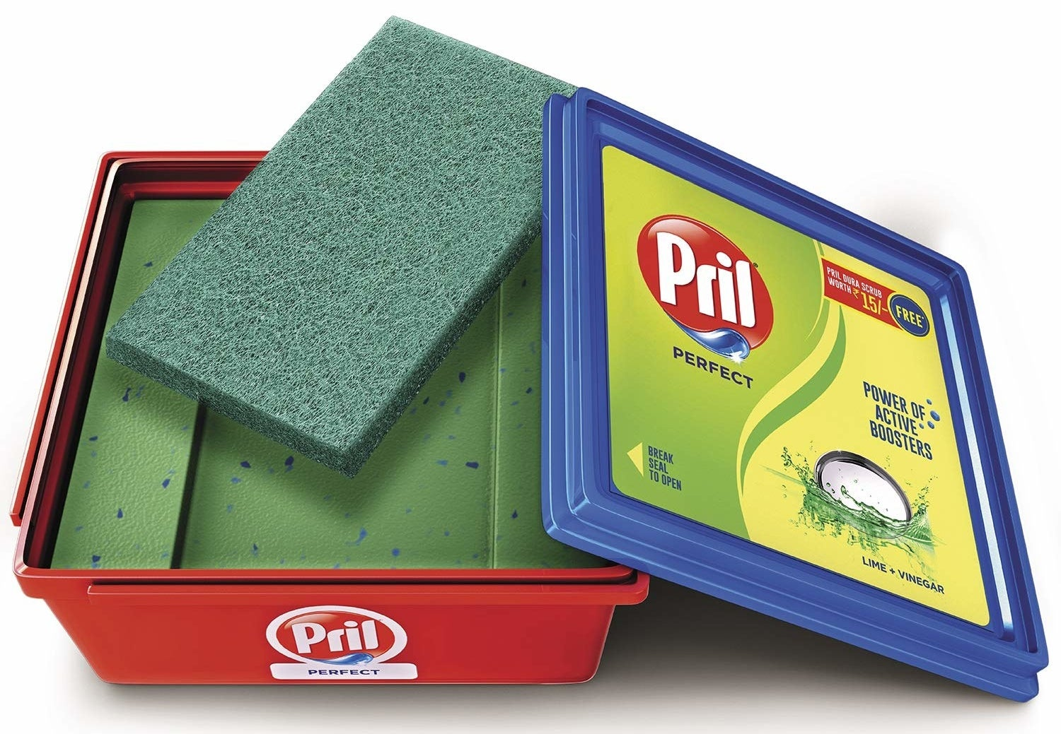 A Pril diswashing bar in a box with a cleaning scrub placed on top.