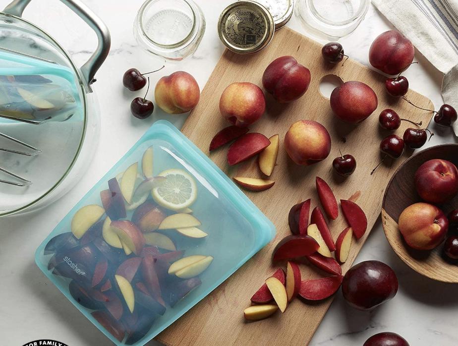 A transparent aqua Stasher bag full of fruit