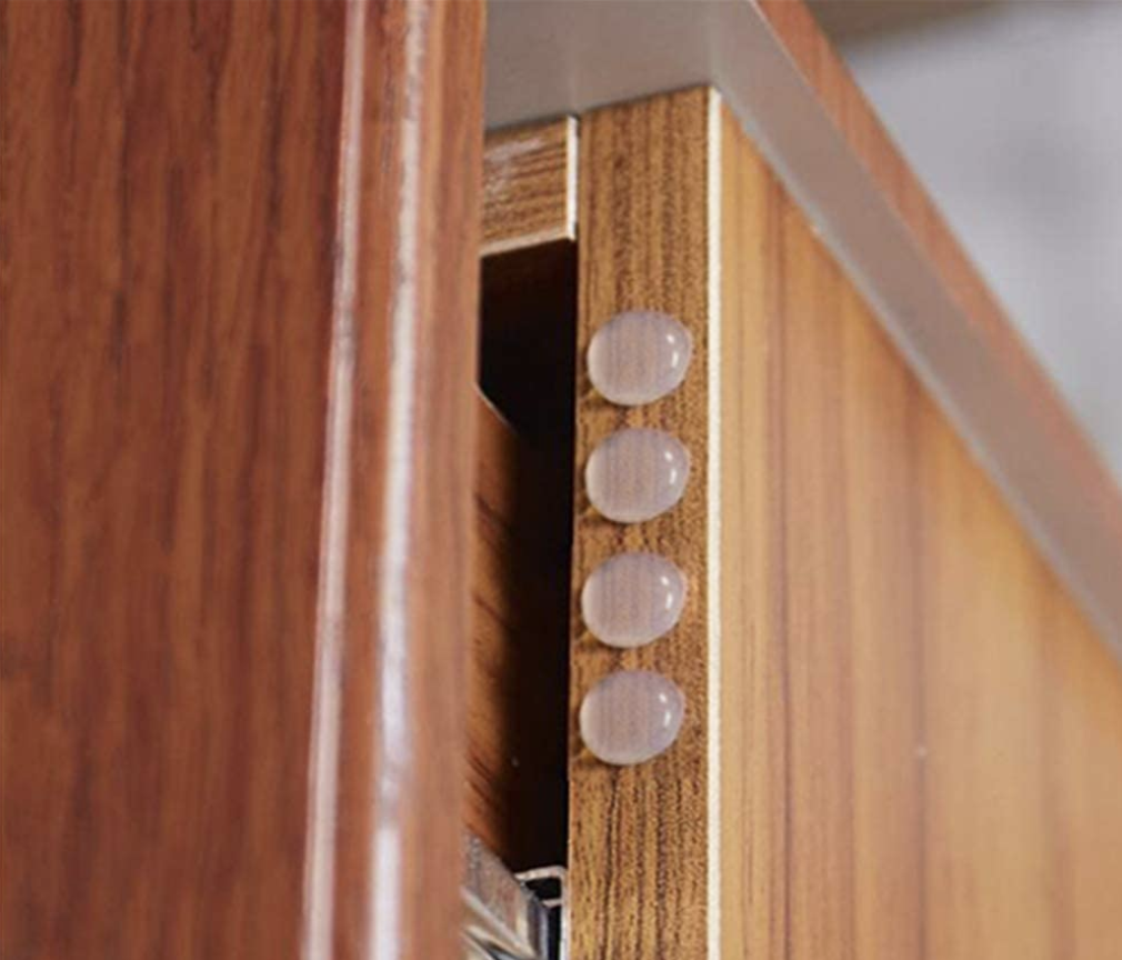 A set of four transparent penny-sized door bumpers