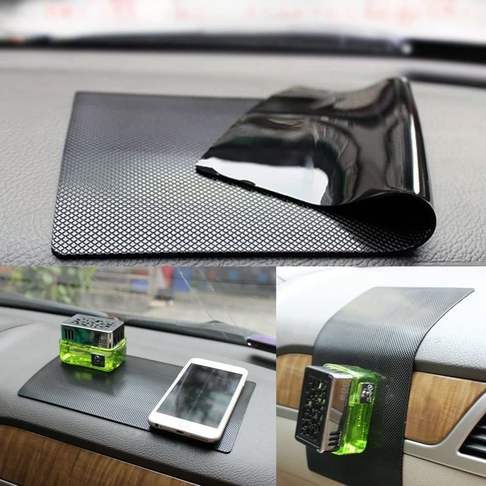 A phone and mini diffuser on a dashboard pad