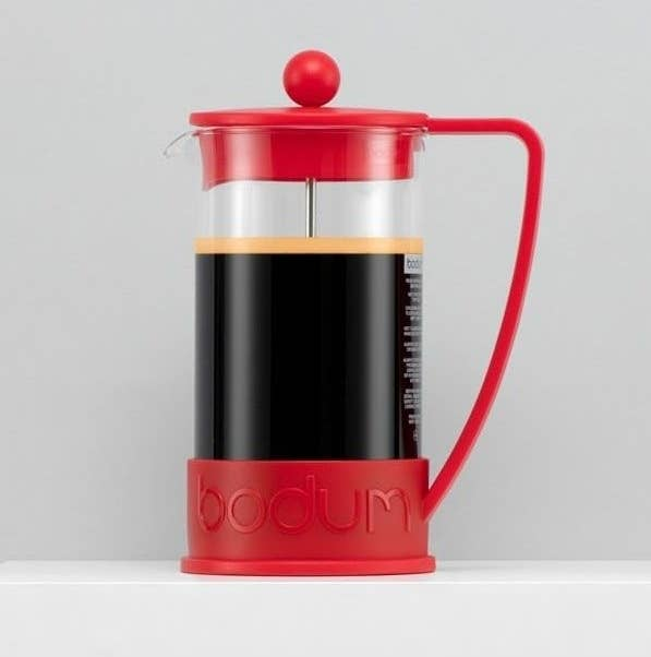 A mini French press filled with coffee