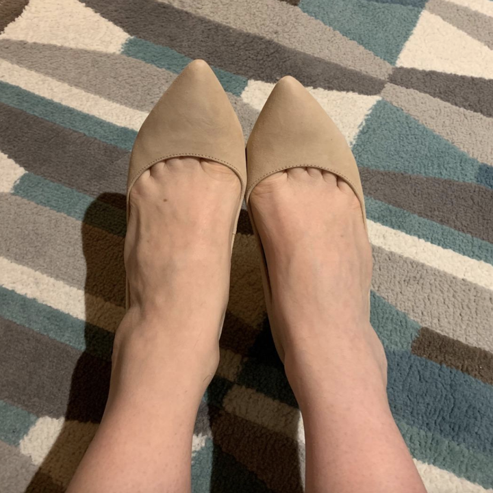 reviewer wearing pointy toe nude pumps