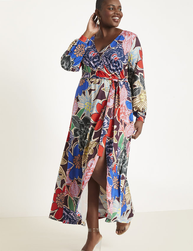 A multi-colored, long sleeve maxi with a high slit at the side and a tie wrap in the front