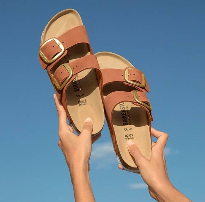 the two-strap sandals in light brown with gold buckle